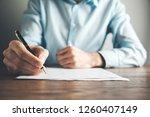 man hand pen with document | Shutterstock . vector #1260407149