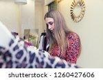 a beautiful woman shopping in a ... | Shutterstock . vector #1260427606