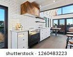 custom kitchen with floor to... | Shutterstock . vector #1260483223