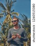 man using cellphone  ... | Shutterstock . vector #1260515380