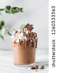 chocolate mousse in a glasses... | Shutterstock . vector #1260533563