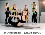 young smiling woman warming up... | Shutterstock . vector #1260550930