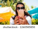 woman making selfie. woman with ... | Shutterstock . vector #1260585850