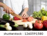 chef prepares fresh vegetables. ...   Shutterstock . vector #1260591580
