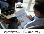 ceo of company analyzing charts ... | Shutterstock . vector #1260662959