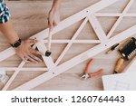 young man assembling wooden...   Shutterstock . vector #1260764443