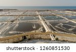 Small photo of shrimp farm, prawn farming with with aerator pump oxygenation water near ocean. aerial view fish farm with ponds growing fish and shrimp and other seafood. Fish hatchery pond aerial view aquaculture