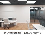coworking office interior with... | Shutterstock . vector #1260870949