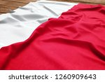 Flag Of Poland On A Wooden Des...