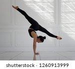 Girl Doing Handstand And Split...