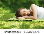 Young Beautiful Woman Laying O...