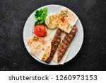 lamb kebab. pita bread and... | Shutterstock . vector #1260973153