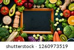 healthy organic food on a blue... | Shutterstock . vector #1260973519