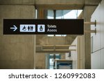 toilet sign direction at airport | Shutterstock . vector #1260992083