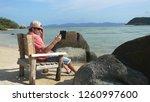 young man is wearing cap... | Shutterstock . vector #1260997600
