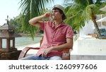 handsome man is drinking water... | Shutterstock . vector #1260997606