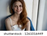 smiling pretty woman near the... | Shutterstock . vector #1261016449