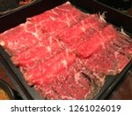 shabu beef  sliced raw beef in... | Shutterstock . vector #1261026019