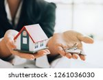 house model and key on table... | Shutterstock . vector #1261036030