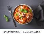 spaghetti with meatballs and... | Shutterstock . vector #1261046356