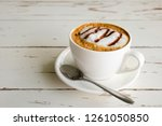 morning cappuccino coffee   on... | Shutterstock . vector #1261050850