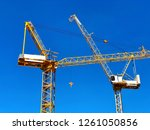 two tower crane construction on ... | Shutterstock . vector #1261050856