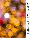 defocus gold bokeh lights... | Shutterstock . vector #1261050859