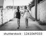 identical twin girls sisters... | Shutterstock . vector #1261069333