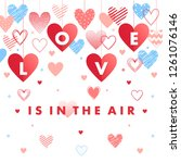 love is in the air   greeting... | Shutterstock .eps vector #1261076146