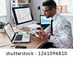 so busy. young businessman in... | Shutterstock . vector #1261096810