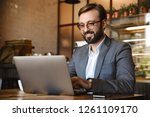 handsome young businessman... | Shutterstock . vector #1261109170