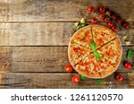 pizza with cheese  chicken and... | Shutterstock . vector #1261120570