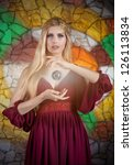 Fantasy style portrait of woman in medieval dress with the �magic sphere� - stock photo