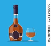 cognac bottle and glass. cognac ... | Shutterstock .eps vector #1261140070