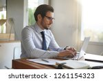 attractive businessman typing... | Shutterstock . vector #1261154323