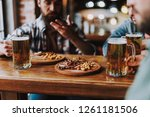 close up of junk food and mugs... | Shutterstock . vector #1261181506