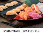 mixed sliced fish sashimi on...   Shutterstock . vector #1261190113