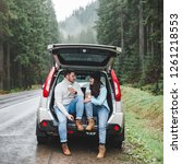 couple stop to drink hot tea....   Shutterstock . vector #1261218553