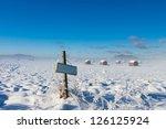 Farm name road sign near winter snowy field - stock photo