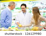 People shopping in a supermarket - stock photo