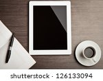 empty tablet and a cup of... | Shutterstock . vector #126133094