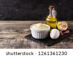 aioli sauce and ingredients on... | Shutterstock . vector #1261361230