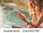 girl using cellphone while... | Shutterstock . vector #1261402789