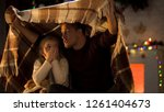 father telling horror christmas ... | Shutterstock . vector #1261404673