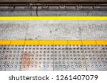 tactile paving at platform edge ... | Shutterstock . vector #1261407079