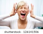 Small photo of young woman shows off her emotional fear and scream