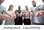 group of people pointing at the ... | Shutterstock . vector #1261435936