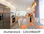 modern kitchen interior with... | Shutterstock . vector #1261486639