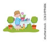 little boy lifting houseplant... | Shutterstock .eps vector #1261499686