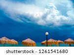 stormy sky over the beach with... | Shutterstock . vector #1261541680
